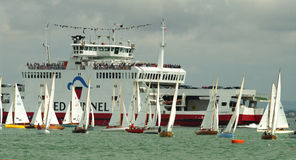 Ferry Boat and dinghies at cowes Week 2010 Stock Photo