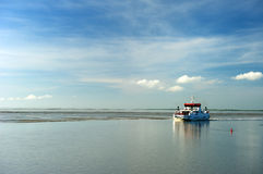 Ferry boat in the Dutch wadden sea Royalty Free Stock Image