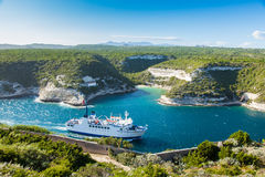 Ferry boat entering Bonifacio port, Corsica island France Royalty Free Stock Photo