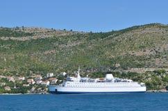 Ferry boat floating near croatian coastline in the Dalmatian riviera. Europe. Croatia. Adriatic sea of Mediterranean area. Summer 2015 Stock Photos