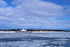 Ferry boat in icy waters during the day Stock Photo