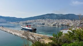 Ferry boat leaving the harbor of Kavala, greece. Panoramic view of Kavala in Greece. A ferry boat just  is leaving the harbor Stock Images