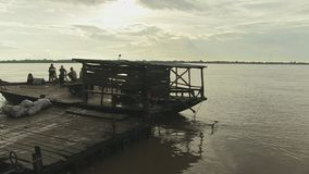 Ferry boat , leaving, mekong,  cambodia, southeast asia stock footage