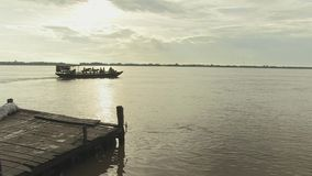 Ferry boat , leaving, mekong,  cambodia, southeast asia stock video footage