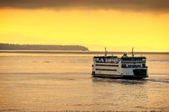 Washington State ferry traveling on the Puget Sound. A ferry boat making the crossing from Whidbey Island to the Mukilteo Ferry Terminal on the Puget Sound in Stock Image