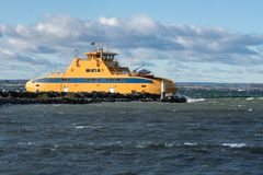 Ferry boat making a narrow turn around a pier Royalty Free Stock Image