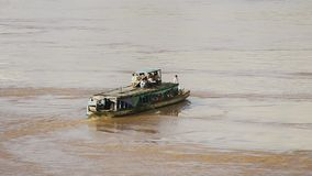 Ferry boat,  mekong, cambodia. People in  local ferry boat  crossing  Mekong river , Kampong Cham town , Cambodia stock video footage