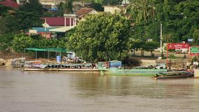 Ferry boat , mekong, cambodia. People in local ferry boat crossing Mekong river , Kampong Cham town , Cambodia stock footage