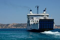 Ferry boat navigating in the middle of the sea. In Sardinia Stock Photos