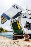 Ferry boat with open ship's bow ready to get loaded. Royalty Free Stock Photo