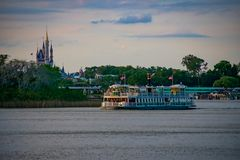 Ferry boat and Panoramic view of Cinderella`s Castle at Walt Disney World area. Orlando, Florida. April 02, 2019. Ferry boat and Panoramic view of Cinderella`s royalty free stock photos
