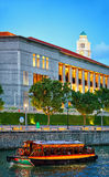 Ferry boat and Parliament building at Boat Quay in Singapore Royalty Free Stock Photo