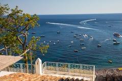 Ferry boat passes fishing boats moored in Tyrrhenian Sea near Positano Italy Royalty Free Stock Image