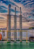 Ferry boat pipes over dramatic sky Stock Photo