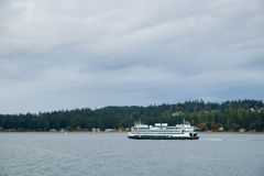 Ferry boat on Puget Sound. Seattle, WA October 1, 2016: Washington State Ferry MV Hyak pass southern end of Bainbridge Island heading for Bremerton , WA Stock Photos