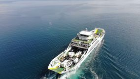 The ferry boat sailing on open sea tracking shot stock video