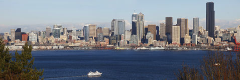 Ferry Boat sailing towards Seattle skyline Royalty Free Stock Images
