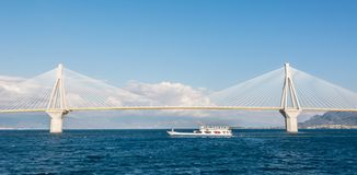 Ferry boat sailing under suspension bridge Royalty Free Stock Photo