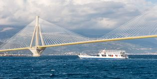 Ferry boat sailing under suspension bridge Stock Photo