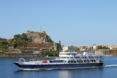 Ferry boat sails close to old fortress  Corfu Stock Photography
