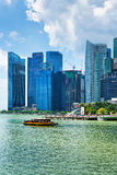 Ferry boat and Skyline of Downtown Core at Marina Bay Stock Photography
