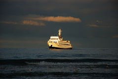 Ferry boat and sunlight Stock Photos