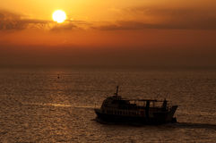 Ferry-boat at sunset Royalty Free Stock Photos