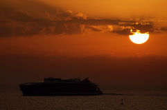 Ferry-boat at sunset Stock Photography