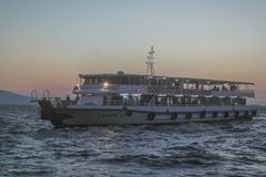 Ferry Boat And Sunset royalty free stock photo