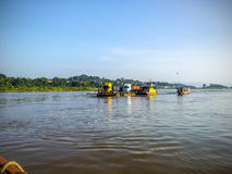 Ferry boat taking truck. Crossing Mekong river royalty free stock photos