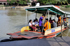 Ferry Boat in Thailand. School children board a boat to cross the  River in Ayutthaya, Thailand Royalty Free Stock Image