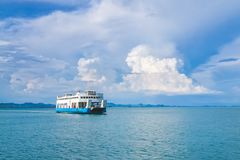 Ferry Boat to Koh Chang Island in Trat, Thailand with big blue s. Ky and cloud for Koh Chang, Thailand Holiday background Stock Images