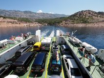 Ferry boat to Rab, Croatia. Rab, Croatia - July 06: Cars and passengers arrive on July 06, 2011 in Rab, Croatia. Tourism triples the population in the summer Royalty Free Stock Photography