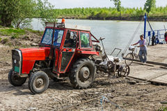 Ferry boat for transport agricultural machinery across the river Royalty Free Stock Images