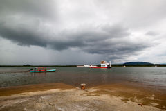 Ferry boat under rainstrom cloud Royalty Free Stock Photography