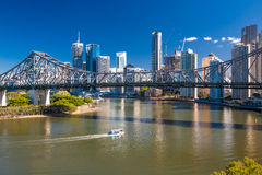 Ferry boat under Story Bridge with skyline of Brisbane, Australi Royalty Free Stock Photography
