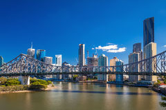 Ferry boat under Story Bridge with skyline of Brisbane Royalty Free Stock Images