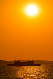 Ferry boat under sun vertical view Stock Images
