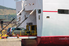 Ferry boat uploading a car in Piombino seaport, Italy. Piombino, Italy - June 30, 2015: Ferry boat Marmorica uploading a car. Ferry with capacity 470 passengers stock photography