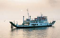 Ferry boat in Venice. Ferry boat parked in Venice lagoon at sunset Royalty Free Stock Photography