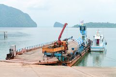 Ferry boat vessel for passengars and cars in Thailand. Ferry boat vessel for passengers and cars to islands in Thailand is parked for maintenance Royalty Free Stock Image