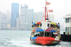 Ferry boat in Victoria Harbor, Hong Kong Stock Photo