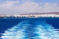 Ferry boat water trail. Ferry boat water trail left over the sea at Lanzarote, Canary Islands Royalty Free Stock Images