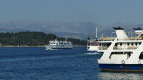 Ferry boats in Corfu sea port, Kerkyra, Greece.  stock video footage