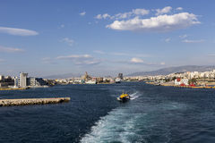 Ferry boats, cruise ships docking at the port of Piraeus, Greece Royalty Free Stock Images