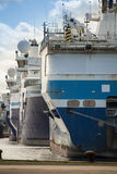 ferry Boats waiting for and docked in port royalty free stock photo