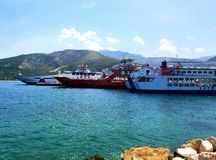 Ferry boats waiting for passengers in a mediterranean c9ve royalty free stock image