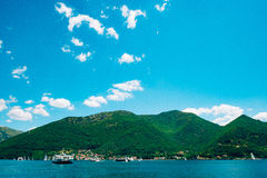 A ferry in the Boka Bay of Kotor in Montenegro, from Lepetane to Royalty Free Stock Images