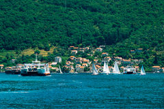 A ferry in the Boka Bay of Kotor in Montenegro, from Lepetane to Stock Photos