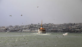Ferry on Bosphorus Istanbul sailing in a snowy day Royalty Free Stock Photography